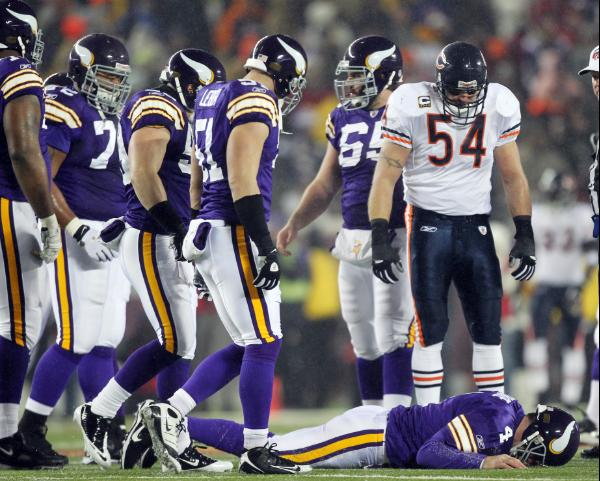 http://beargoggleson.com/files/2010/12/urlacher-stands-over-favre.jpg