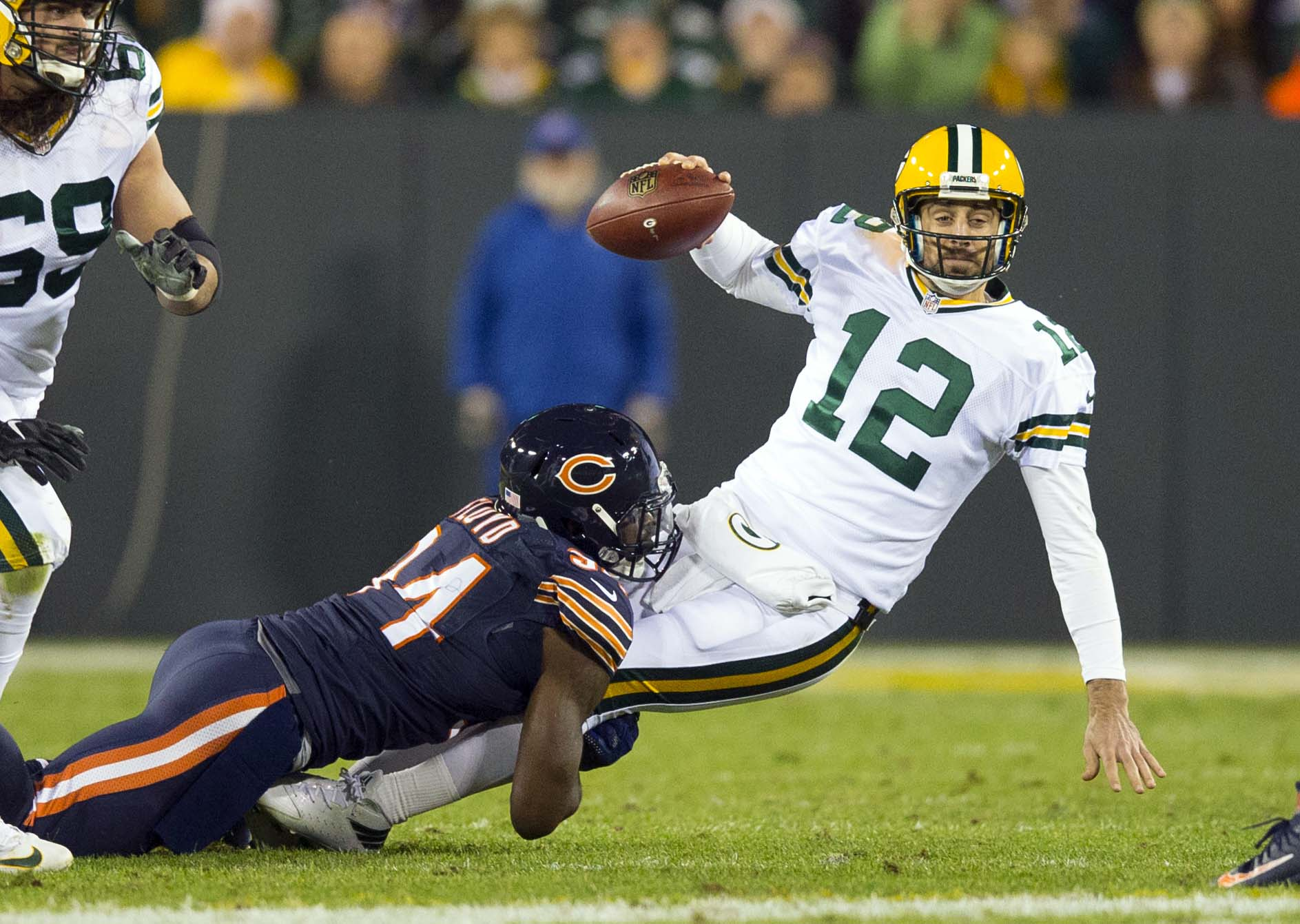 ef230af406a Oct 20, 2016; Green Bay, WI, USA; Green Bay Packers quarterback Aaron  Rodgers (12) is sacked by Chicago Bears linebacker Leonard Floyd (94)  during the ...
